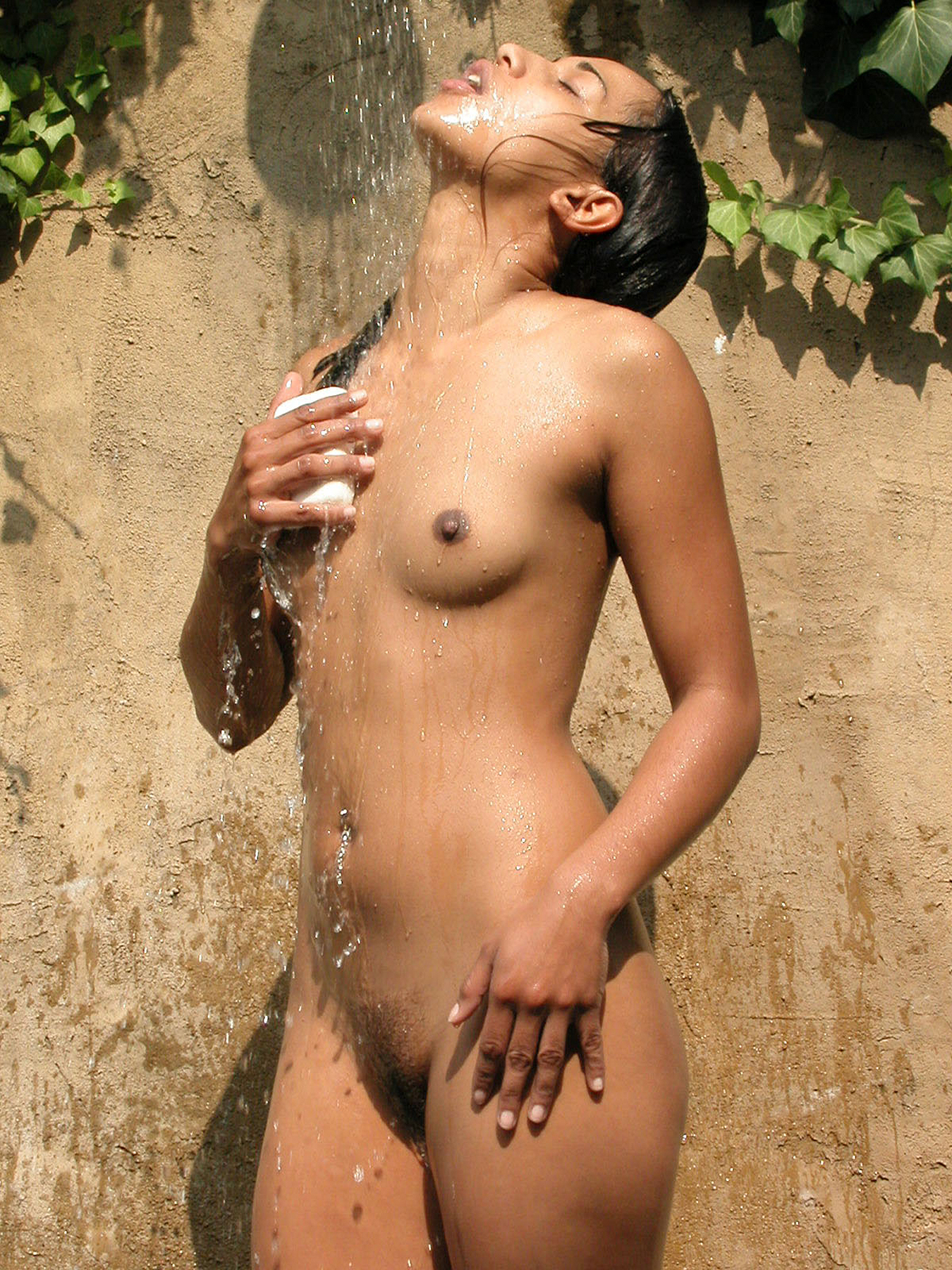 Hannah_frontal_nude_eyes_closed_dreamy_August_2003_bathing_outdoors_love