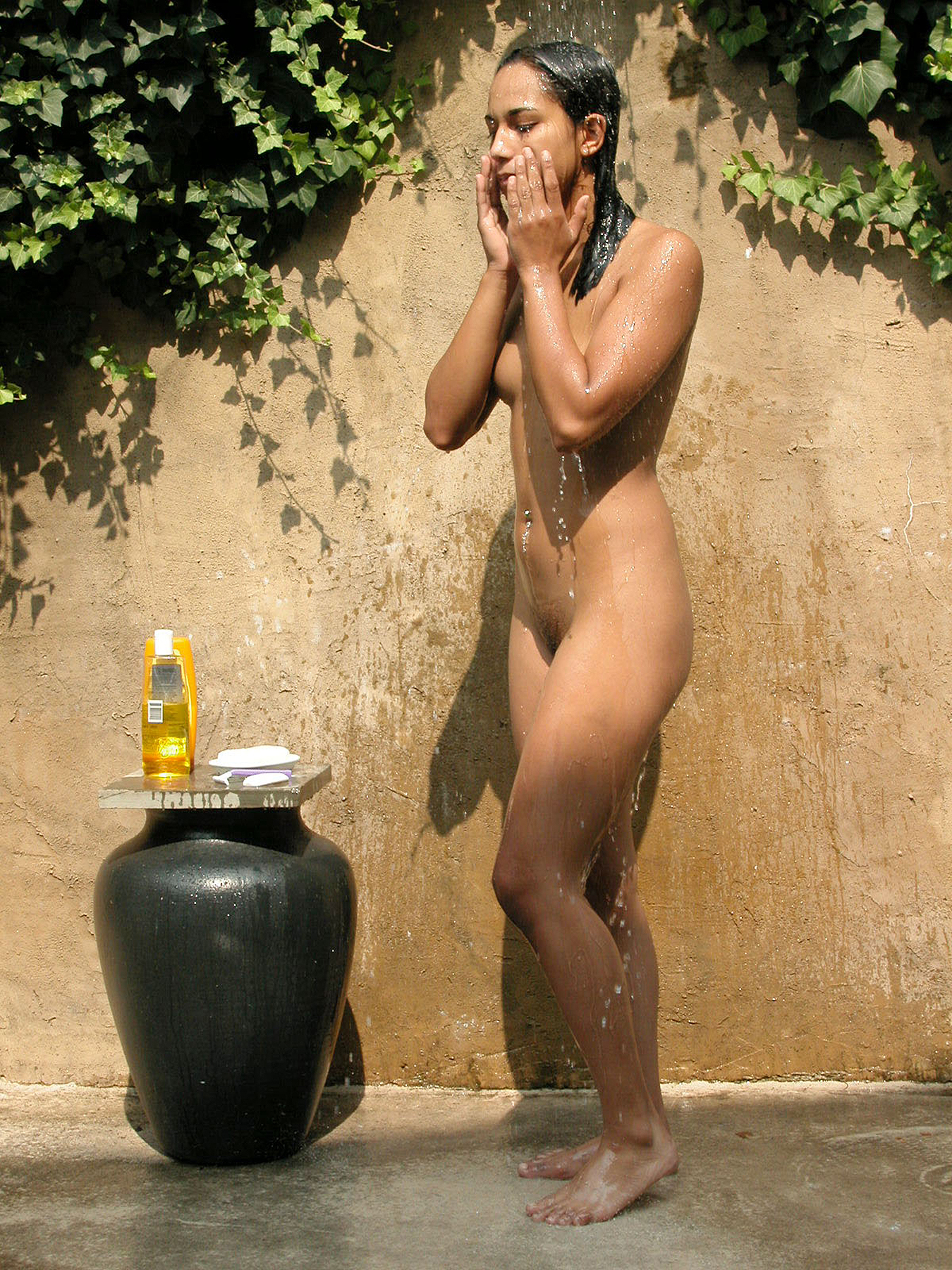 Hannah_frontal_nude_eyes_closed_dreamy_August_2003_bathing_outdoors_water