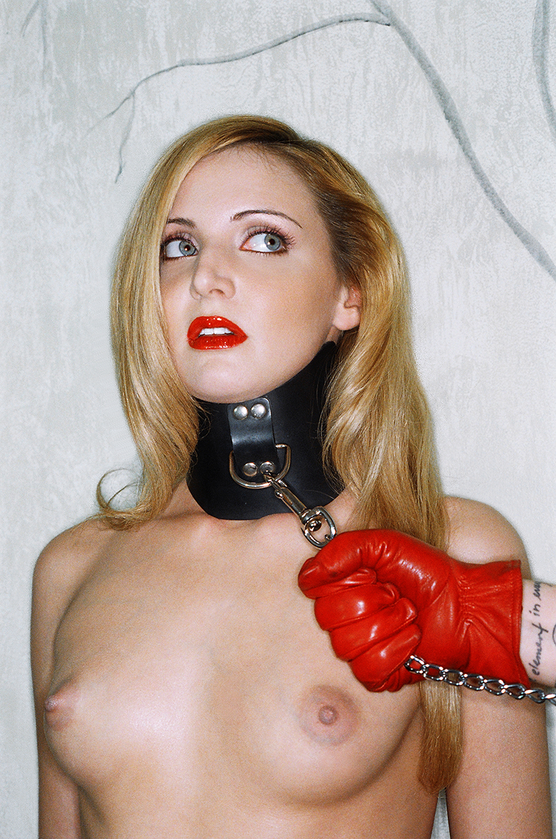 Tony_Ward_fetish_photography_red_leather_glove_neck_restraint_dog_chain